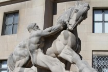 """""""Man Controlling Trade"""" statue outside of the Federal Trade Commission Building in Washington, DC."""